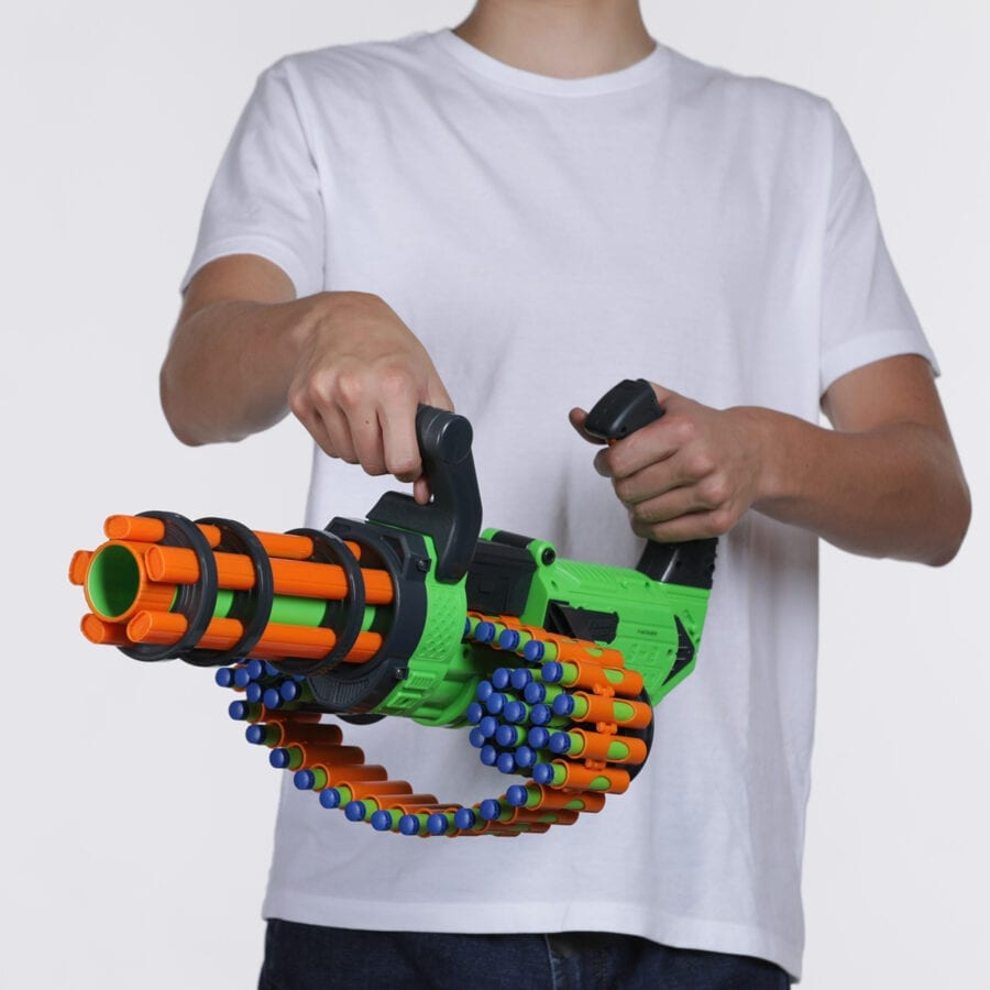 Held View of the Adventure Force V-Twin High Power Automatic Motorized Toy Foam Gatling Belt Dart Blaster