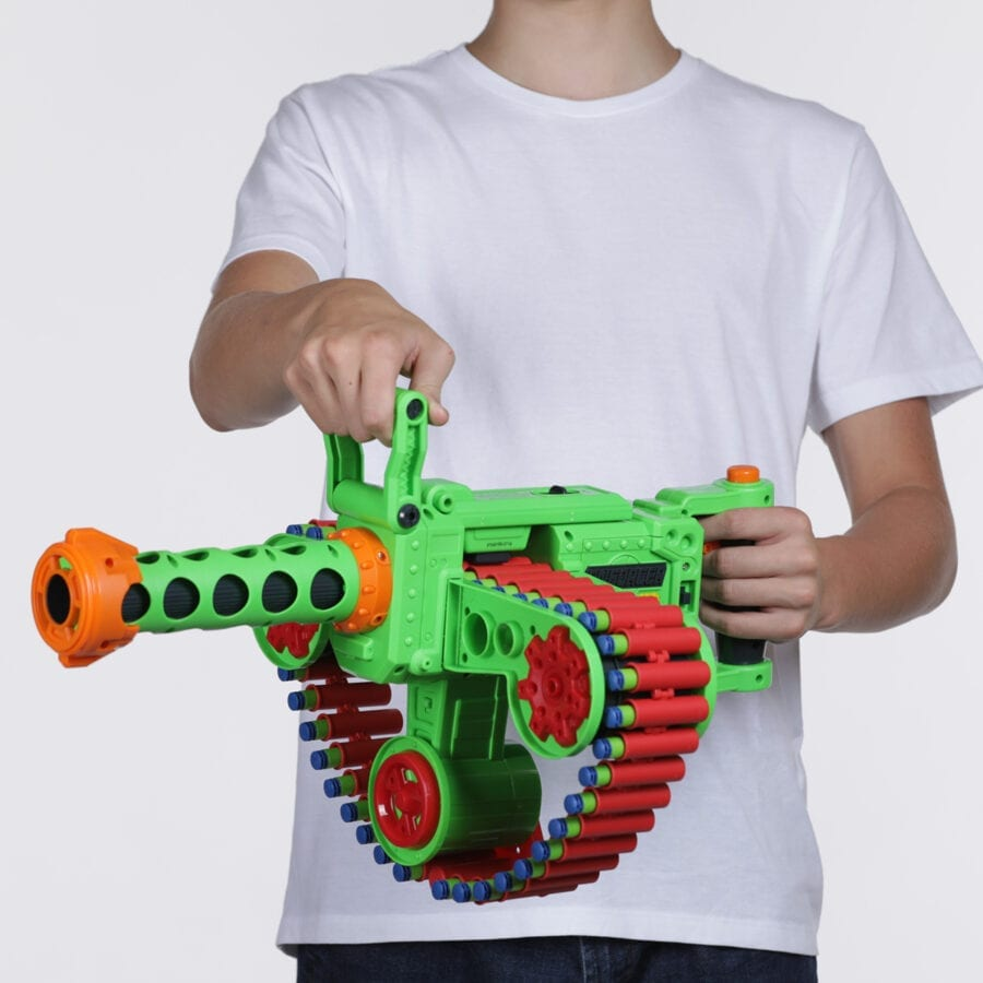 Held View of the Automatic High Power Belt Fed Toy Foam Enforcer Super Commando Dart Blaster With Waffle Tip Darts and Targets